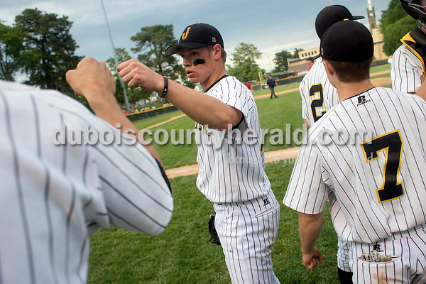 Jasper's Cal Krueger was congratulated by Grant Theil after Wednesday night's Class 3A baseball sectional at Ruxer Field in Jasper. Jasper won 7-2. Dave Weatherwax/The Herald