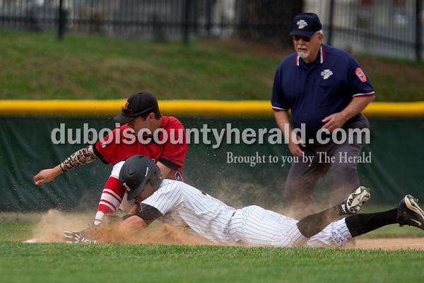 Jasper's Evan Aders slid safely into third base as Southridge's Ross Eckert mishandled the throw during Wednesday night's Class 3A baseball sectional at Ruxer Field in Jasper. Jasper won 7-2. Dave Weatherwax/The Herald