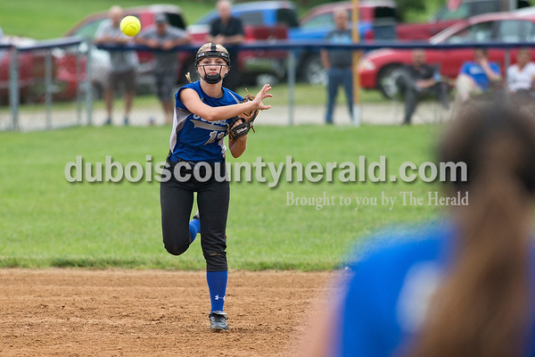 Northeast Dubois' Brooklyn Dodd fired a throw to first base during the Class 1A softball sectional championship against Tecumseh in Dubois. The Jeeps lost 2-0. Dave Weatherwax/The Herald