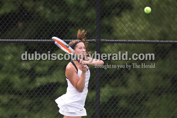Jasper's Mallory Ahlbrand played Providence's Clare Hooper during the girls tennis semistate championship at Jasper High School on Saturday. Jasper defeated Providence 3-2. Sarah Ann Jump/The Herald