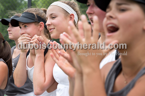 Jasper's Kathleen Messmer, left, Sarah Monesmith, Caroline Theil, Maria Lueken and Maggie Getzin reacted as they watched their teammates play doubles matches, one win away from securing the semistate title, during the girls tennis semistate championship at Jasper High School on Saturday. Jasper defeated Providence 3-2. Sarah Ann Jump/The Herald