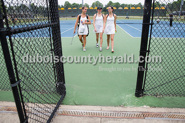 Jasper's Emma Seger, left, Maria Lueken and Emma Yarbrough walked off the court after their team won the semistate title during the girls tennis semistate championship at Jasper High School on Saturday. Jasper defeated Providence 3-2. Sarah Ann Jump/The Herald