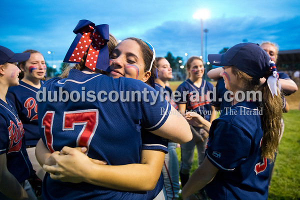 Heritage Hills' Meagan Kralj, left, and Jonathyn Hatchett embraced after Thursday's Class 3A sectional championship game in Boonville. The Heritage Hills Patriots lost to the Boonville Pioneers 8-2. Sarah Ann Jump/The Herald