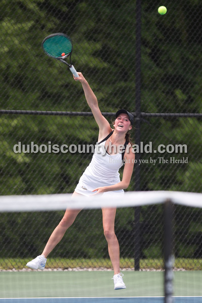 Jasper's Maria Lueken played Providence's Halli Trinkle during the girls tennis semistate championship at Jasper High School on Saturday. Jasper defeated Providence 3-2. Sarah Ann Jump/The Herald