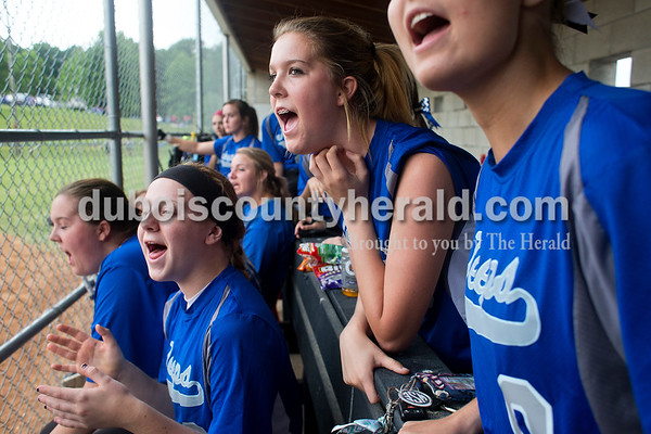 Northeast Dubois' Brittany Dodd, left, AJ Kirchoff and Bethany Dodd cheered on their teammate during the Class 1A softball sectional championship against Tecumseh in Dubois. The Jeeps lost 2-0. Dave Weatherwax/The Herald