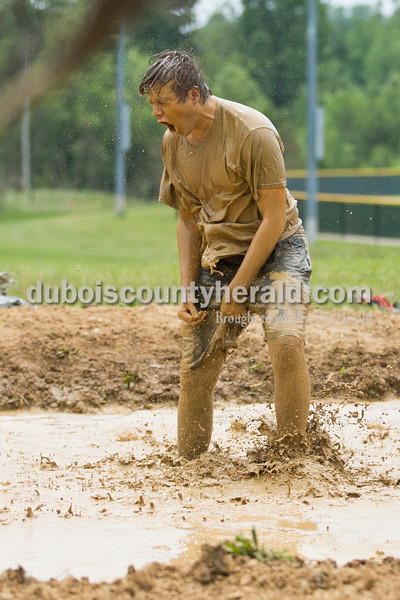 Sarah Ann Jump/The Herald Jasper High School senior Matthew Britzman jumped in the mud and screamed to get pumped up before a game during the school's annual mud volleyball tournament on Wednesday.