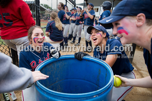 Heritage Hills' Haley Begle, left, and Jonathyn Hatchett sang a song as Rebeka Mercker hit a barrel with a softball to create a beat during Thursday's Class 3A sectional championship game in Boonville. The Heritage Hills Patriots lost to the Boonville Pioneers 8-2. Sarah Ann Jump/The Herald