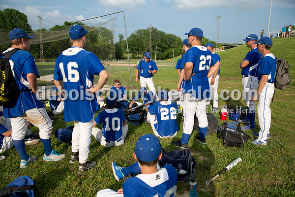 The Northeast Dubois baseball team gathered to listen to coach Brian Kirchoff talk after Friday's Class 1A sectional semi-final game in Cannelton. The Northeast Dubois Jeeps defeated the Cannelton Bulldogs 17-2 in five innings. Sarah Ann Jump/The Herald