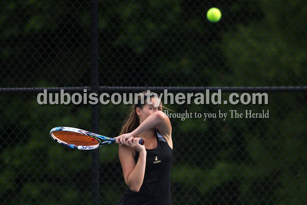 Jasper's Mallory Ahlbrand struck a return during the tennis regional championship against Paoli on Wednesday evening at Jasper High School. The Wildcats won the championship and will move on to semistate this Saturday.  Alisha Jucevic/The Herald