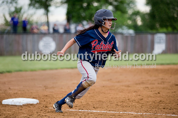 Heritage Hills' Xiana Scott ran towards home before the ball was caught for the final out of the inning during Thursday's Class 3A sectional championship game in Boonville. The Heritage Hills Patriots lost to the Boonville Pioneers 8-2. Sarah Ann Jump/The Herald