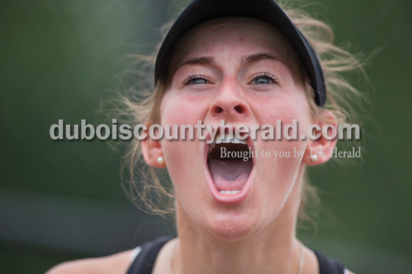 Jasper's Sarah Monesmith cheered for her teammates playing doubles matches, one win away from securing the semistate title for Jasper, during the girls tennis semistate championship at Jasper High School on Saturday. Jasper defeated Providence 3-2. Sarah Ann Jump/The Herald
