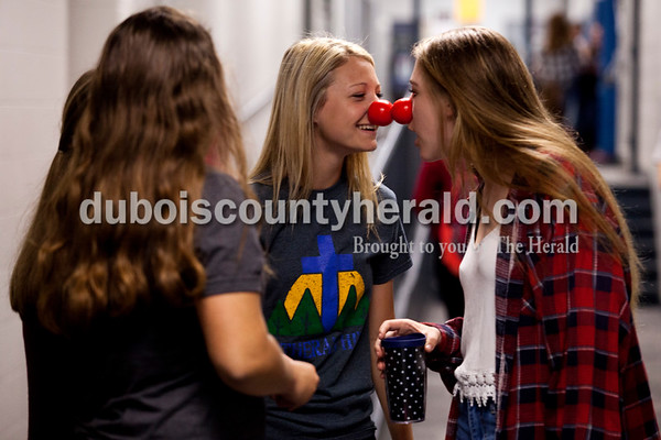 Alisha Jucevic/The Herald   Northeast Dubois High School freshman Brooklyn Dodd, left, and Clare Mangin bopped their red noses together as they cleaned out their lockers Thursday morning in Dubois. Northeast Dubois teacher Karen Terwiske and the Beta Club led the efforts to sell around 200 noses to students during their homeroom period to support Red Nose Day. This national campaign brings people together with comedy to raise money for children and young adults living in poverty.