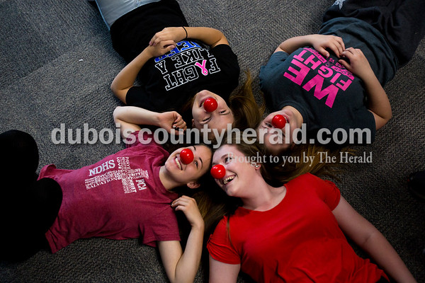 Alisha Jucevic/The Herald   Northeast Dubois High School freshman Sierra Ward, clockwise from left, Haley Bean, Sierra's twin Natasha Ward and Sierra Jones donned red noses as their friend snapped a photo Thursday morning in Dubois. Northeast Dubois teacher Karen Terwiske and the Beta Club led the efforts to sell around 200 noses to students during their homeroom period to support Red Nose Day. This national campaign brings people together with comedy to raise money for children and young adults living in poverty.