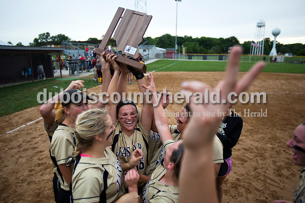Jasper's Nicolette Eckert hoisted the Class 3A sectional championship trophy as the Wildcats celebrated their 3-0 win over Pike Central in Petersburg. The Wildcats will move on to play Boonville in the regional championship on Tuesday at the Jasper Youth Sports Complex.  Alisha Jucevic/The Herald