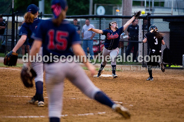 Heritage Hills' Lauren Caswell missed the catch as Boonville's Blaire Leslie ran to first base during Thursday's Class 3A sectional championship game in Boonville. The Heritage Hills Patriots lost to the Boonville Pioneers 8-2. Sarah Ann Jump/The Herald