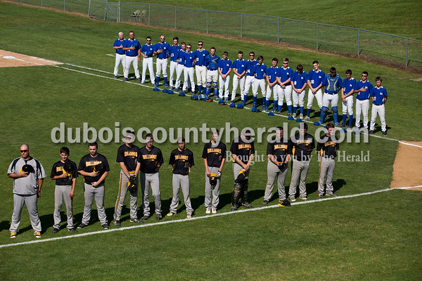 The Northeast Dubois and Cannelton baseball teams stood for the national anthem before Friday's Class 1A sectional semi-final game in Cannelton. The Northeast Dubois Jeeps defeated the Cannelton Bulldogs 17-2 in five innings. Sarah Ann Jump/The Herald