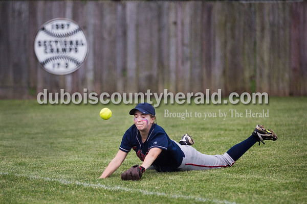 Heritage Hills' Abbie Fischer fell chasing a ball in the outfield during Thursday's Class 3A sectional championship game in Boonville. The Heritage Hills Patriots lost to the Boonville Pioneers 8-2. Sarah Ann Jump/The Herald