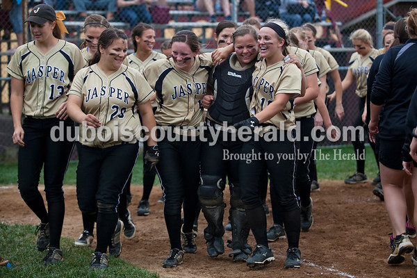 Jasper's Katelyn Hedinger, left, Olivia Burger, Paige Werner, Lindsay Mehringer and Nicolette Eckert walked to the edge of the field with their team as they waited for the trophy announcement after Thursday night's Class 3A sectional championship against Pike Central in Petersburg. The Wildcats secured a 3-0 win and will move on to play Boonville in the regional championship on Tuesday at the Jasper Youth Sports Complex.  Alisha Jucevic/The Herald