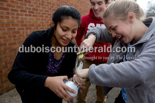 On Feb. 23., eighth-graders Tatiana Delgado, left, and Chaney Barrett struggled get wet soil out of a measuring cup and into a plastic bag so it could be sent away for testing.