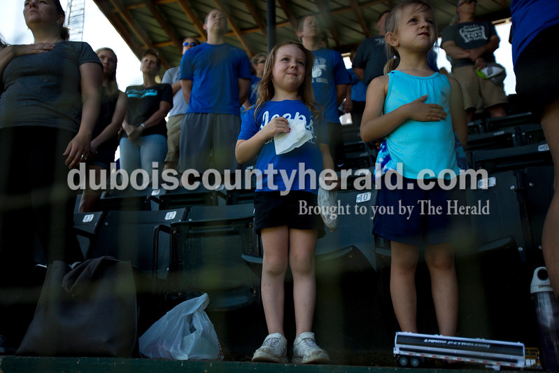 Northeast Dubois fans Dexi Kirchoff, 6, and Kaydee Kluesner, 5, both of Dubois stood for the national anthem during Monday's Class 1A sectional championship against Tecumseh in Cannelton. The stadium's pre-recorded song would not play, so the crowd took over and sang the anthem themselves. Northeast Dubois defeated Tecumseh 6-1 to win the sectional title. <br /> <br /> Alisha Jucevic/The Herald