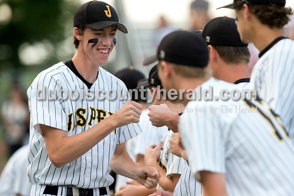 Jasper's Logan Mathies went down the line of teammates during player introductions at the start of the Class 3A sectional championship Monday night at Ruxer Field in Jasper. The Wildcats defeated Princeton 5-0. Dave Weatherwax/The Herald