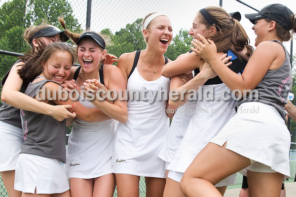 The Jasper girls tennis team celebrated as the doubles team of Emma and Olivia Yarbrough won their match, securing the semistate title for Jasper, during the girls tennis semistate championship at Jasper High School on Saturday. Jasper defeated Providence 3-2. Sarah Ann Jump/The Herald