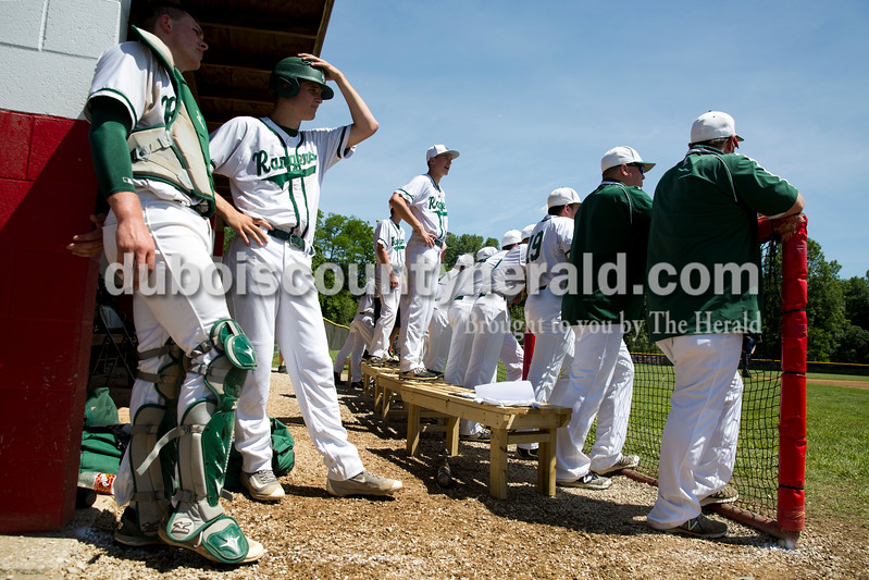 Forest Park baseball players and coaches watched the game from the dugout at Monday's Class 2A sectional championship in Tell City. The Forest Park Rangers lost to the South Spencer Rebels 5-0. Sarah Ann Jump/The Herald