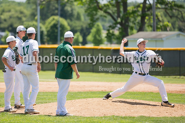 Forest Park's David Lusk, right, warmed up to pitch during Monday's Class 2A sectional championship in Tell City. Lusk was the fourth pitcher the Rangers played during the game. The Forest Park Rangers lost to the South Spencer Rebels 5-0. Sarah Ann Jump/The Herald