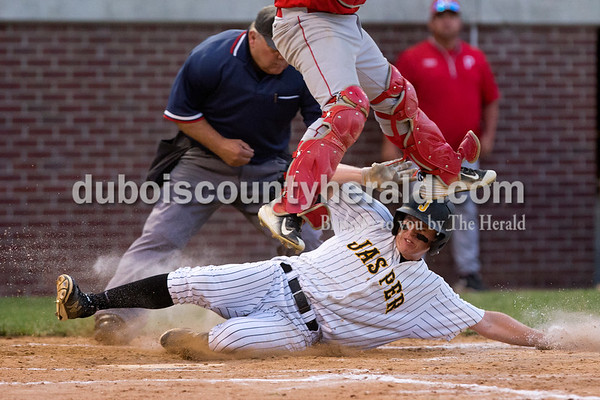 Jasper's Brandon Bayer slid safely into home plate during the Class 3A sectional championship Monday night at Ruxer Field in Jasper. The Wildcats defeated Princeton 5-0. Dave Weatherwax/The Herald