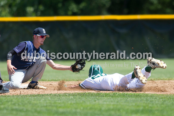 Forest Park's Sam Englert slide into second base as South Spencer's Kobe Stephens tagged him out during Monday's Class 2A sectional championship in Tell City. The Forest Park Rangers lost to the South Spencer Rebels 5-0. Sarah Ann Jump/The Herald