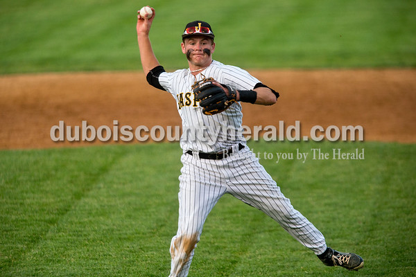 Jasper second baseman Reece Kleinhelter made the throw to first base during the Class 3A sectional championship Monday night at Ruxer Field in Jasper. The Wildcats defeated Princeton 5-0. Dave Weatherwax/The Herald