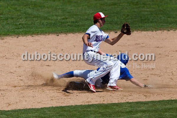 Northeast Dubois' Parker Zehr slid safe into second as Tecumseh's Jack Jackson caught the ball during Monday's Class 1A sectional championship in Cannelton. Northeast Dubois defeated Tecumseh 6-1 to win the sectional title.   Alisha Jucevic/The Herald