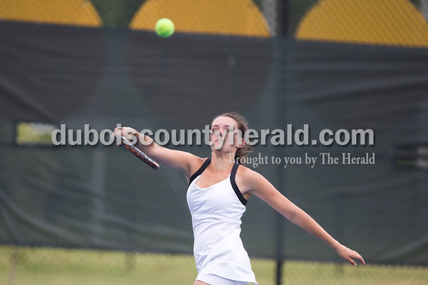 Jasper's Olivia Yarbrough hit the ball during her doubles match with partner Emma Yarbrough against Providence's Isabel Coe and Hannah Conder at the girls tennis semistate championship at Jasper High School on Saturday. Jasper defeated Providence 3-2. Sarah Ann Jump/The Herald