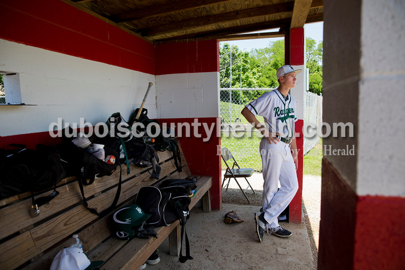 Forest Park's Reid Brown stood in the dugout after being replaced as pitcher mid-inning during Monday's Class 2A sectional championship in Tell City. Brown was the second of four pitchers the Rangers played and he pitched for less than one inning. The Forest Park Rangers lost to the South Spencer Rebels 5-0. Sarah Ann Jump/The Herald