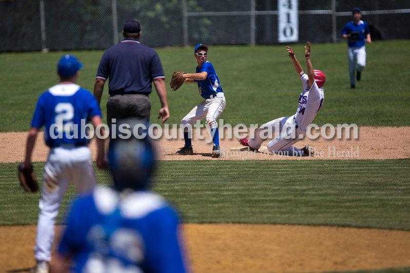 Northeast Dubois' Jaden Brosmer threw to first as Tecumseh's Woody Brucken slid late into second during Monday's Class 1A sectional championship against Tecumseh in Cannelton. Northeast Dubois defeated Tecumseh 6-1 to win the sectional title. <br /> <br /> Alisha Jucevic/The Herald