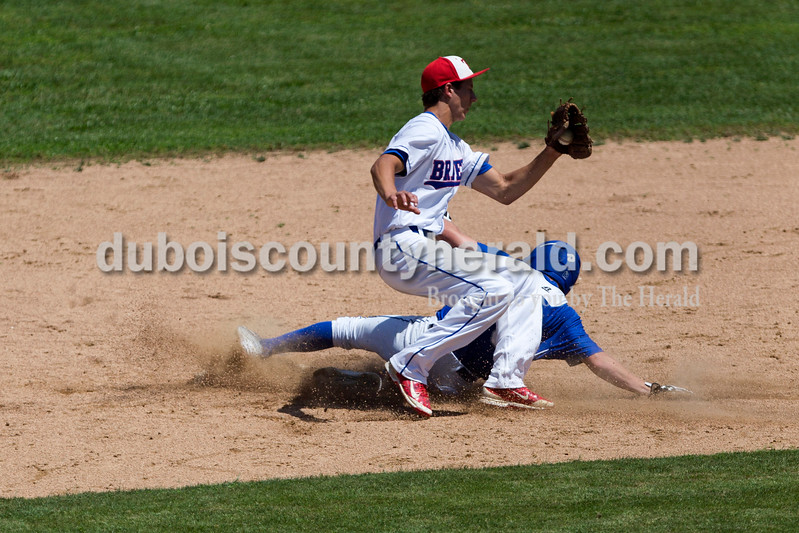 Northeast Dubois' Parker Zehr slid safe into second as Tecumseh's Jack Jackson caught the ball during Monday's Class 1A sectional championship in Cannelton. Northeast Dubois defeated Tecumseh 6-1 to win the sectional title. <br /> <br /> Alisha Jucevic/The Herald