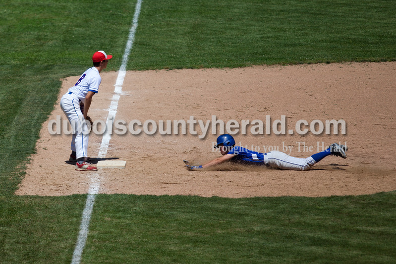 Northeast Dubois' Jaden Brosmer slide safe into third as Tecumseh's Jonny Jenkins looked for a pass during Monday's Class 1A sectional championship in Cannelton. Northeast Dubois defeated Tecumseh 6-1 to win the sectional title. <br /> <br /> Alisha Jucevic/The Herald
