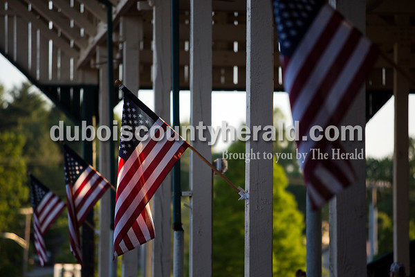 American flags flapped in the wind during Friday night's game between the Dubois County Bombers and the Owensboro Oilers at League Stadium in Huntingburg. The Bombers won 6-2.  Alisha Jucevic/The Herald