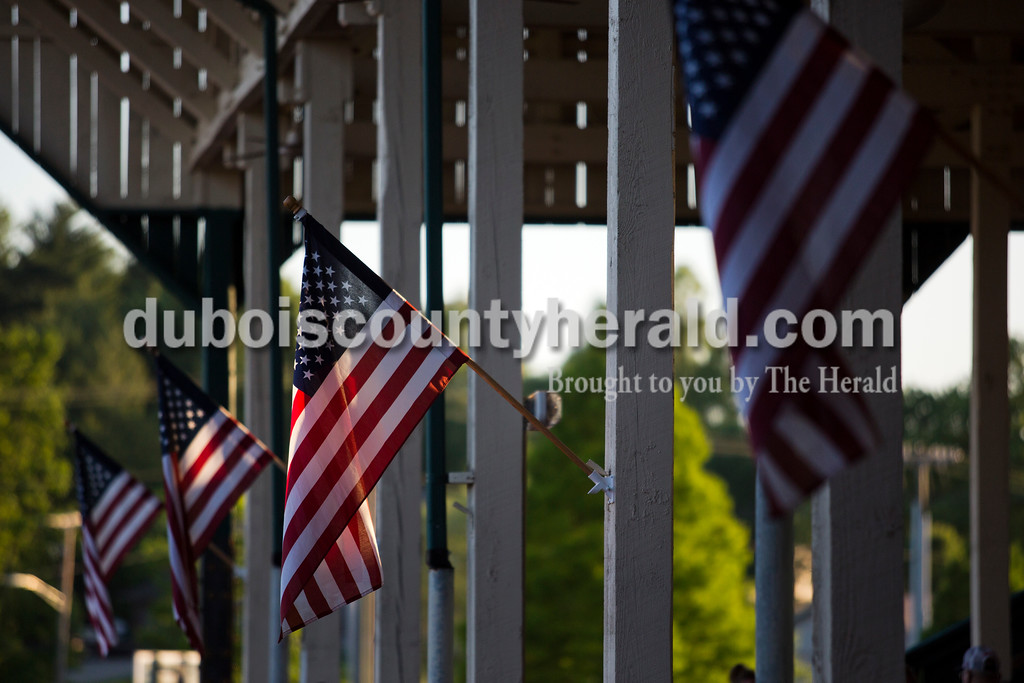 American flags flapped in the wind during Friday night's game between the Dubois County Bombers and the Owensboro Oilers at League Stadium in Huntingburg. The Bombers won 6-2. <br /> Alisha Jucevic/The Herald