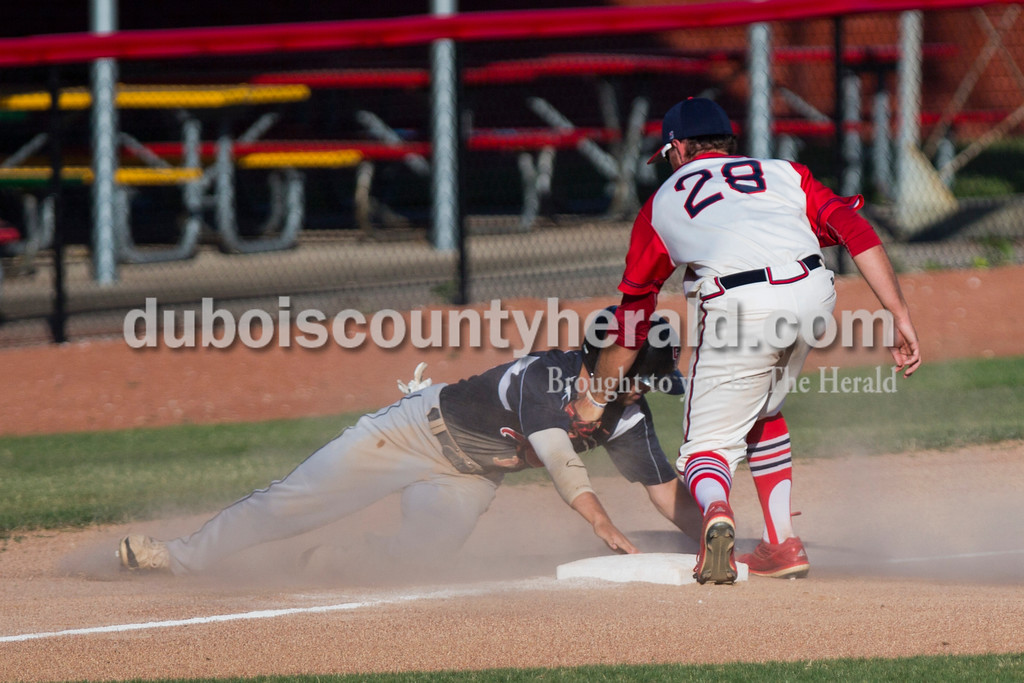 Bombers' Macy Holdsworth tagged out Owensboro's Mitch Wilson during Friday night's game at League Stadium in Huntingburg. The Bombers won 6-2. <br /> Alisha Jucevic/The Herald