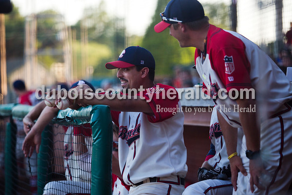 Bombers' Raunel Perez talked with assistant coach Greg Gogel during Friday night's game against the Owensboro Oilers at League Stadium in Huntingburg. The Bombers won 6-2.  Alisha Jucevic/The Herald