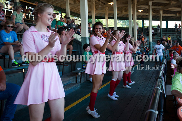 """Natalie Altstadt, 21, left, and her cousin Jaclyn Altstadt, 22, both of Huntingburg, danced to """"Cotton Eye Joe,"""" during Friday night's game between the Dubois County Bombers and the Owensboro Oilers at League Stadium in Huntingburg. The Bombers won 6-2.  Alisha Jucevic/The Herald"""