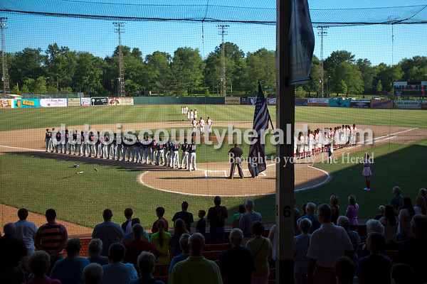 The stadium stood for the national anthem before Friday night's game between the Dubois County Bombers and the Owensboro Oilers at League Stadium in Huntingburg. The Bombers won 6-2.  Alisha Jucevic/The Herald