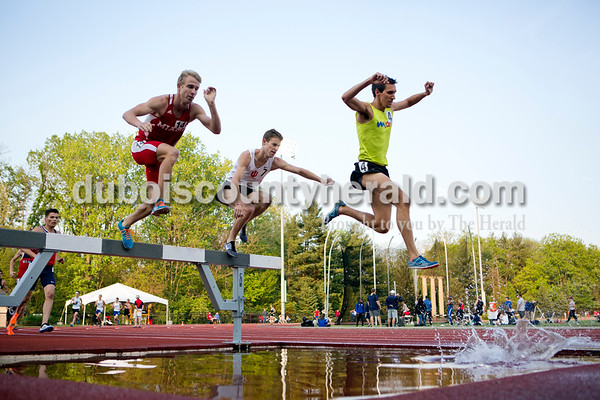"""Nolan Fife of Terre Haute, left, Robby Nierman of Bloomington and Dustin soared over the water jump during the 3000 meter steeplechase at the Billy Hayes Invitational at Indiana University on May 6. Fife was acting as a """"rabbit"""" for Nierman and Dustin by running a quick pace to set them up before bowing out and leaving it to them to battle for first place. Nierman is also trying to qualify for the Olympic Trials. Dustin came in second place in the race behind Nierman."""