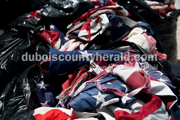 Sarah Ann Jump/The Herald Flags were collected by all Dubois County veterans organizations to be burned during the Dubois County Veterans Council's annual flag disposable ceremony at the 4-H Fairgrounds in Bretzville on Saturday afternoon.