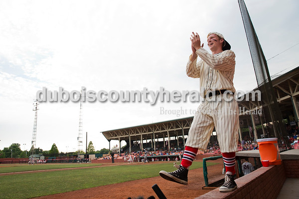 Kru Allen of Holland, 17, dressed as the Bombers' mascot Casey, danced on the ledge between innings during Tuesday evening's game between the Dubois County Bombers and Paducah Chiefs at League Stadium in Huntingburg. The Bombers won 4-2. Sarah Ann Jump/The Herald