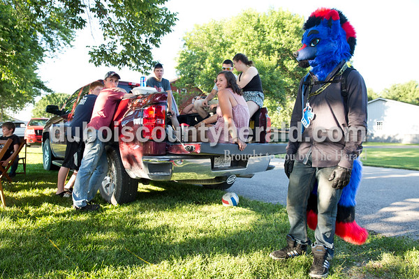 """Sarah Ann Jump/The Herald Tyler Jochem of Ferdinand, 16, right, portrayed a character he created named Kyle during Heinrichsdorf Fest in St. Henry on Friday evening. """"After you make a character, you can give it any personality you want,"""" said Jochem.""""In the furry fandom, everyone treats you like family."""""""