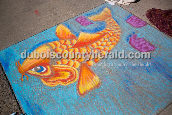 Concrete squares were filled with color on Saturday for the 13th annual Jasper Arts Center Chalk Walk around the Courthouse Square in downtown Jasper.  Alisha Jucevic/The Herald