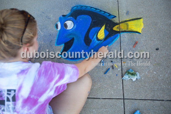 Concrete squares were filled with color on Saturday for the 13th annual Jasper Arts Center Chalk Walk around the Courthouse Square in downtown Jasper. Sarah Obermeier of Jasper, 14, worked on her drawing of Dori during the early hours of Saturday's event.  Alisha Jucevic/The Herald