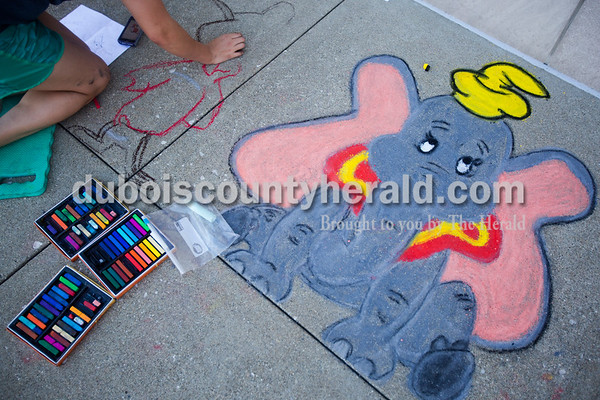 Emma Messmer of Jasper, 16, worked on her drawings of Timothy Q Mouse and Dumbo during Saturday's 13th annual Jasper Arts Center Chalk Walk around the Courthouse Square in downtown Jasper.  Alisha Jucevic/The Herald